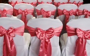 wedding-chair-covers-coral-sashes1